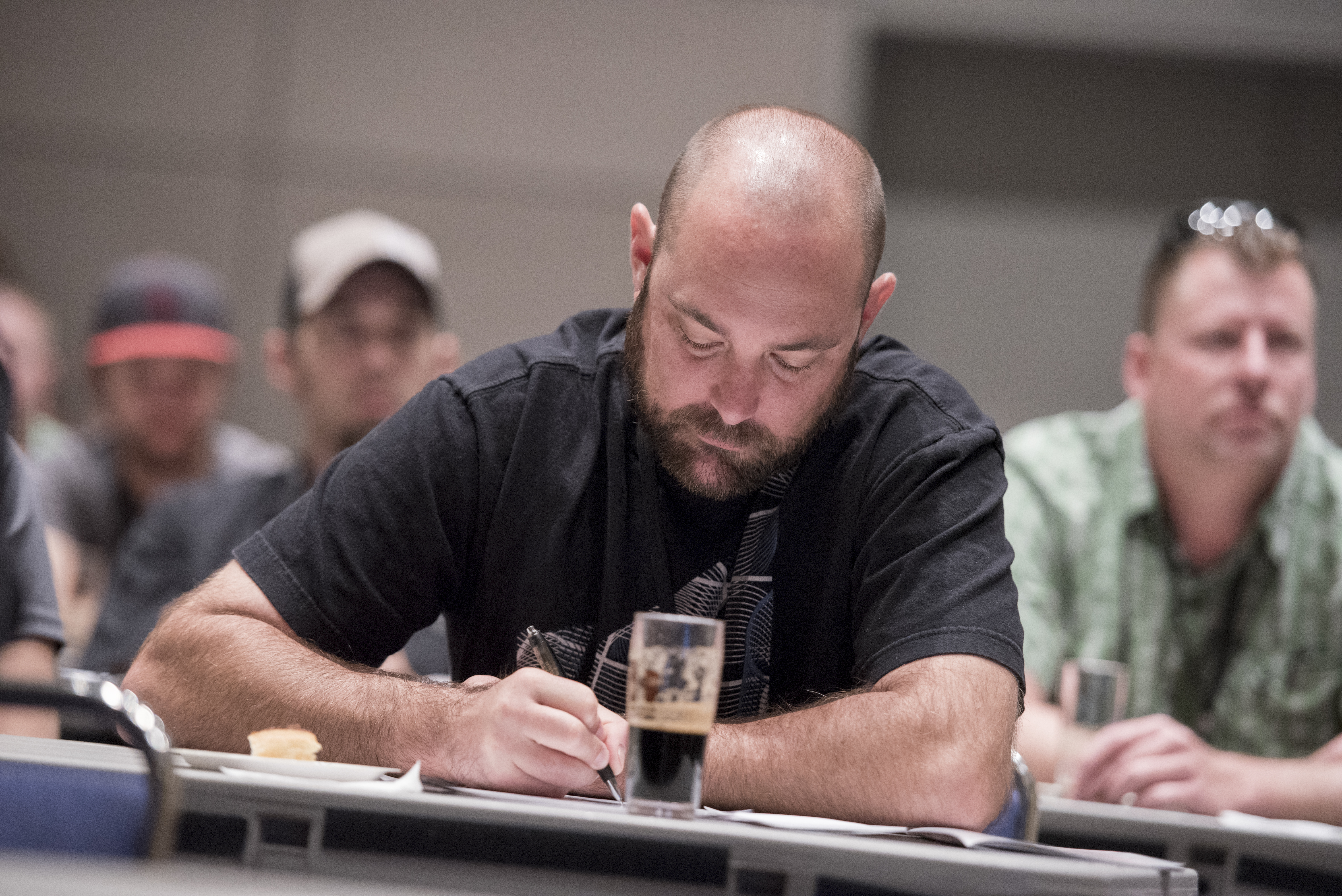 California Craft Beer Summit attendee taking notes
