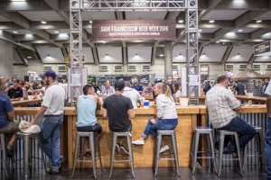 an image of last years Summit Expo event with people sitting at a bar tasting beers and talking together