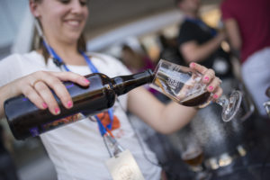 woman pouring a beer