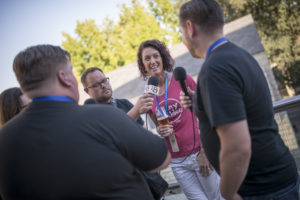 people interviewing woman at craft beer summit