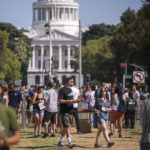 people walking at the state capital