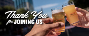 """a close up image of two hands clinking their beer glasses together with the words """"Thank you for joining us"""" over the top"""