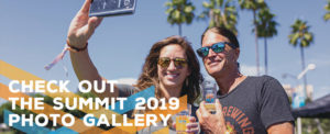 an image of a man and woman posing for a selfie outdoors with the words 'Check out the summit 2019 photo gallery' superimposed on top
